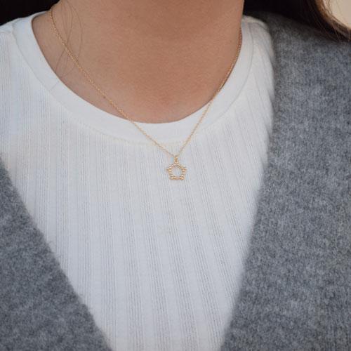 collar estrella hueca oro