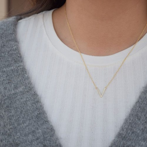 collar oro v